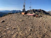 Looking south-southwest on Mount Baldy at the weather telemetry sensors and ski patrol equipment.